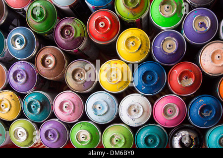 Coloured spray paint cans - Stock Photo