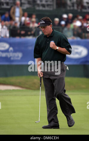 Mar 03, 2005; Miami, FL, USA; PHIL MICKELSON reacts to sinking a birdie putt on the 18th hole to finish the first - Stock Photo