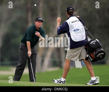 Mar 03, 2005; Miami, FL, USA; PHIL MICKELSON tosses his ball to his caddie after making a bogey on the 10th hole. - Stock Photo