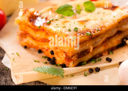 Juicy homemade lasagna with beef meat.Selective focus in the middle of lasagna - Stock Photo