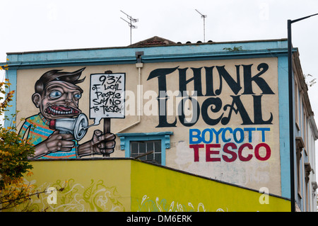 Think Local Boycott Tesco slogan on wall in Stokes Croft area of Bristol. - Stock Photo