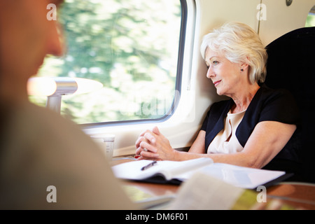 Businesswoman Relaxing On Train Journey - Stock Photo