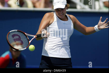 Apr 23, 2005; Delray Beach, FL, USA; LINDSAY DAVENPORT returns a volley against Eveline Vanhyfte during their match - Stock Photo