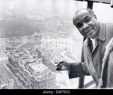 Jan 14, 1966 - London, England, United Kingdom - HENERY JACKSON taking a good look at London from his hotel room. - Stock Photo