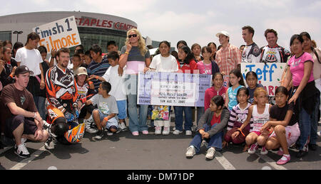June 15, 2005; Los Angeles, CA, USA; X Games athletes and students from the 10th Street Elementary School gather around the first ticket to ESPN's X Games 11 during the ESPN X GAMES 11 KICKOFF event at Staples Center. Mandatory Credit: Photo by Vaughn Youtz/ZUMA Press. (©) Copyright 2005 by Vaughn Youtz.