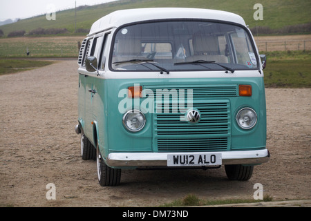 Volkswagen campervan parked at Kimmeridge Bay in February - Stock Photo