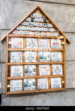 Display of traditional ceramic tile street names as tourist souvenirs, Madrid, Spain - Stock Photo