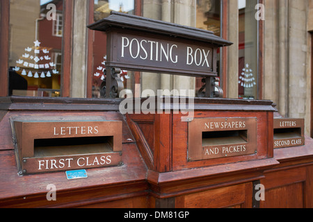 Old fashioned wooden posting box outside the main Post Office in Oxford city centre - Stock Photo