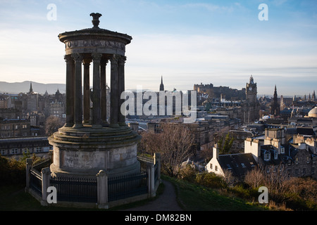 The Dugald Stewart Monument on Calton Hill with Edinburgh city centre in the background - Stock Photo