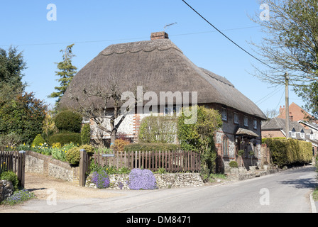 Traditional thatched roof cottage in the village of Owslebury in Hampshire, England, UK - Stock Photo