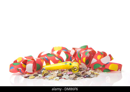 streamers and confetti as decoration for parties, sylvester with white background - Stock Photo