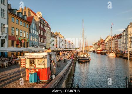 Promenade at Nyhavn in Copenhagen, Denmark in the evening light - Stock Photo