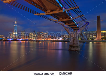 The Millennium Bridge, spanning the Thames  river London,  connecting St Paul's Cathedral with Tate Modern art gallery. - Stock Photo
