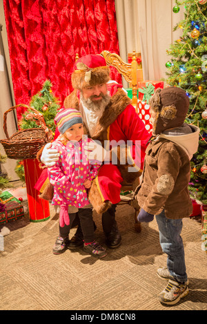 Father Christmas with children, Burnaby Village Museum, Burnaby, British Columbia, Canada - Stock Photo