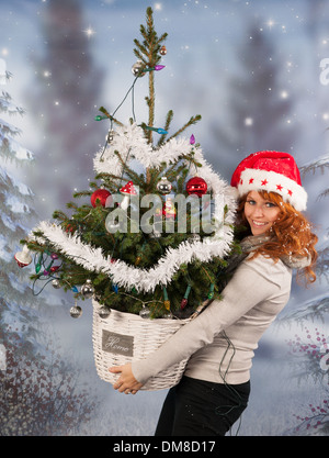 Woman is bringing home the decorated Chirstmas tree - Stock Photo