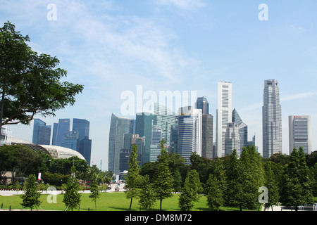 View across War Memorial Park and into downtown Singapore. Tall buildings of the Financial District are visible. - Stock Photo