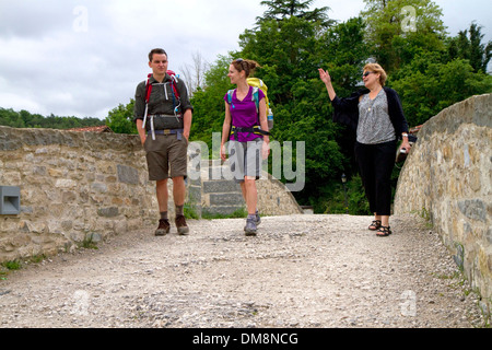 Modern day pilgrims walk along the Camino De Santiago, the Way of St. James pilgrimage route, Navarra, Spain. - Stock Photo