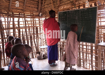 Maasai children at English lecture in the Ngorongoro Conservation Area in the Crater Highlands area of Tanzania - Stock Photo