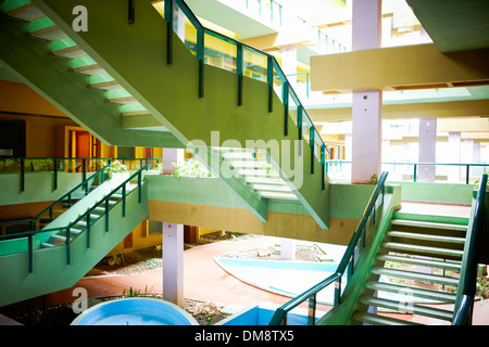 Colorful stairs in an apartment complex - Stock Photo