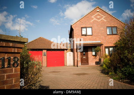 detached house houses home uk four bedroom suburban suburbs suburb double garage big large family homes executive - Stock Photo