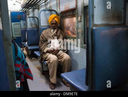 (131213) -- PUNJAB, Dec. 12, 2013 (Xinhua) -- A Punjabi cancer patient sits on a train at the railway station of - Stock Photo
