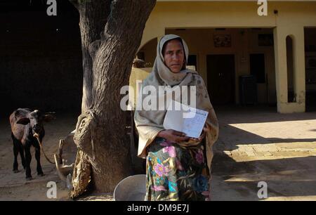 (131213) -- PUNJAB, Dec. 12, 2013 (Xinhua) -- A Punjabi woman Sarabjeet Kour suffering from cancer shows her prescription - Stock Photo