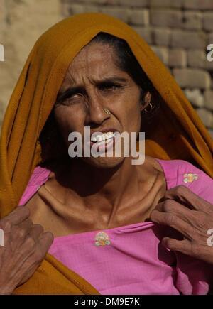 (131213) -- PUNJAB, Dec. 12, 2013 (Xinhua) -- A Punjabi woman Karamjeet Kour explains her suffering from cancer - Stock Photo