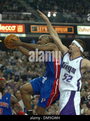 Nov 08, 2005; Sacramento, CA, USA; Piston CHAUNCEY BILLUPS is fouled by Kings BRAD MILLER during the game between - Stock Photo