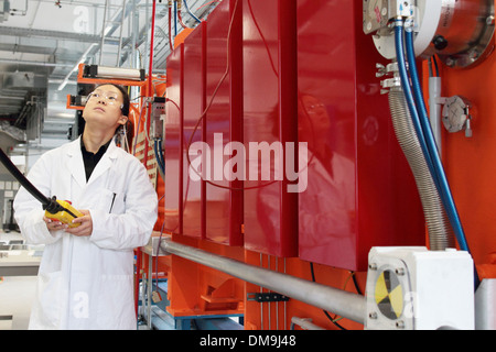 an asia woman scientist working in a lab with a lab coat - Stock Photo