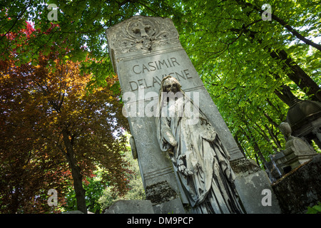 GRAVE OF THE AUTHOR CASIMIR DELAVIGNE ORNAMENTED WITH AN ALLEGORICAL STATUE OF POETRY, PERE-LACHAISE CEMETERY, PARIS - Stock Photo