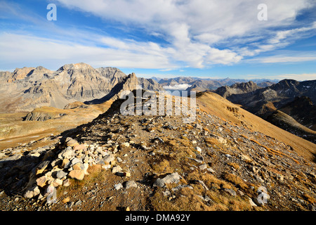 Mountain footpath leading up to the top of M. Thabor (3178 m) in afternoon light on barren terrain, italian-french - Stock Photo