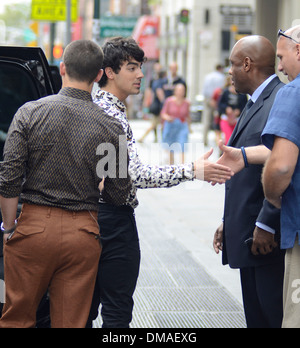 Nick Jonas and Joe Jonas of Jonas Brothers leaving their apartment in New York City New York City USA - 20.08.12 - Stock Photo