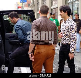 Kevin Jonas Nick Jonas and Joe Jonas of Jonas Brothers leaving their apartment in New York City New York City USA - Stock Photo
