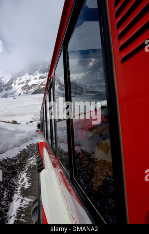 Snowcoaches at the Athabasca Glacier. Banff and Jasper National Parks. Alberta. Canada - Stock Photo