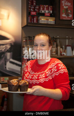 Liverpool, Merseyside, UK. 13th December, 2013.   Chole Butcher Serving muffins at Costa Coffee and wearing Yuletide - Stock Photo