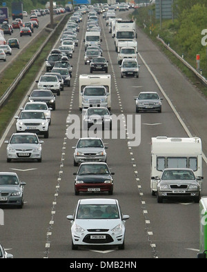 Heavy motorway traffic heading south near Weston Super Mare, Somerset, ahead of the bank holiday weekend. 24 May - Stock Photo