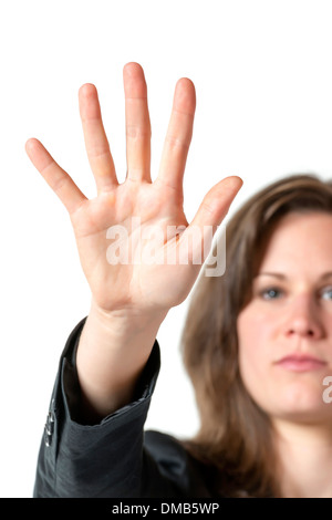 Business woman in black suit holds her hand up to stop someone or something, isolated on white background - Stock Photo