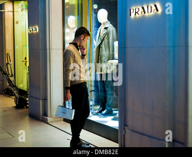Paris, France, Young Chinese Man, Shopping Street, Luxury Brand Store, Prada, Shop Front WIndow, on Avenue Montaigne - Stock Photo