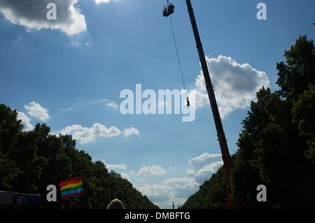People doing bungee jumping during the Christopher Street Day (Gay Pride Parade) in Berlin - Stock Photo