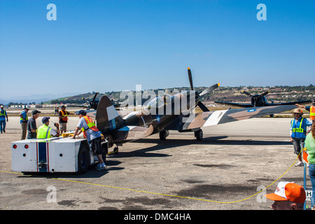 The Spitfire MK XIV being towed by a tug at The Wings over Camarillo Air Show In Camarillo California - Stock Photo