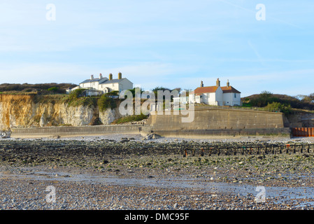 The Coastguard cottages at low tide at Cuckmere Haven, East Sussex, UK - Stock Photo