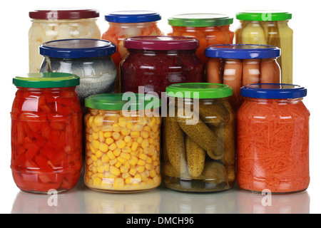 Canned vegetables such as corn, pickles and paprika in glass jars - Stock Photo