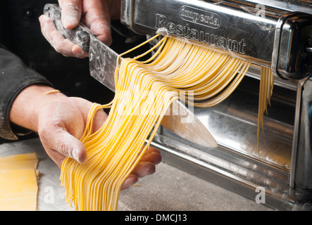 fresh pasta manual production - Stock Photo