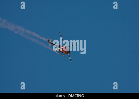 The Red Bull Aerobatic Helicopter At the Wings Over Camarillo Airshow in Camarillo California in August of 2011 - Stock Photo