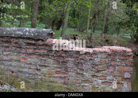 Perished or damaged old brickwork on a canal bridge in the Midlands. - Stock Photo