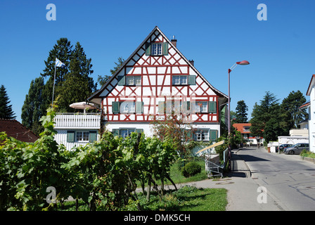 Half-timbered house on the shore of Lake Constance in the wine village Nonnenhorn near Lindau. - Stock Photo