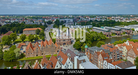 Warehouses and Holsten Gate, Hanseatic city of Lübeck, Schleswig-Holstein, Germany - Stock Photo