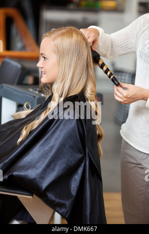 Woman At Parlor Making Her Hair Curly - Stock Photo