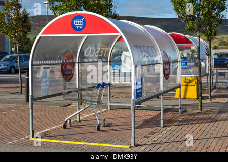 SUPERMARKET TROLLEY COLLECTION STANDS AND CAR PARK - Stock Photo