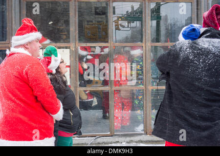 Christmas revelers at the Grey Lady bar in the Lower East Side neighborhood of New York during the annual SantaCon - Stock Photo